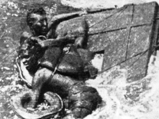 Prisoners of war cling to debris duing the rescue after the sinking of the Rokyu
