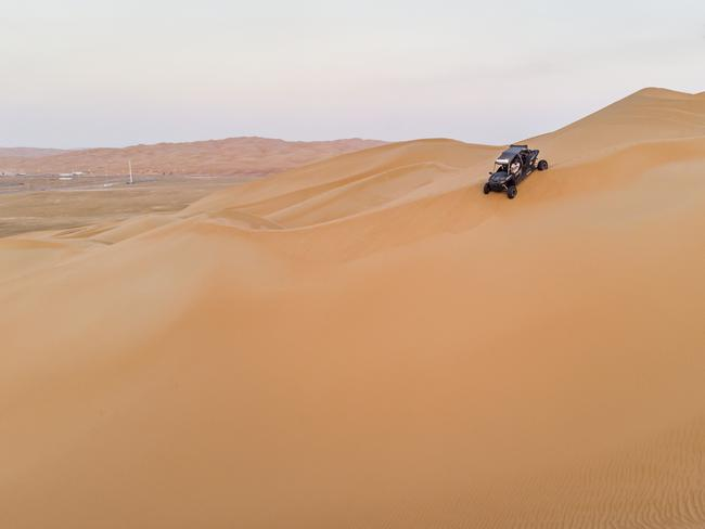 15. DUNE BUGGY ON LIWA DESERT'S SAND DUNES Ride the dunes UAE-style. A quick buggy lesson and you're set loose on these giant sand dunes on the outskirts of Abu Dhabi. If slipping and sliding up and down golden sands as far as the eye can see doesn't get your adrenaline going, nothing will.