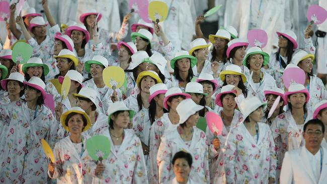 Members of the delegation from Japan walk at the Athens 2004 Summer Olympic Games.