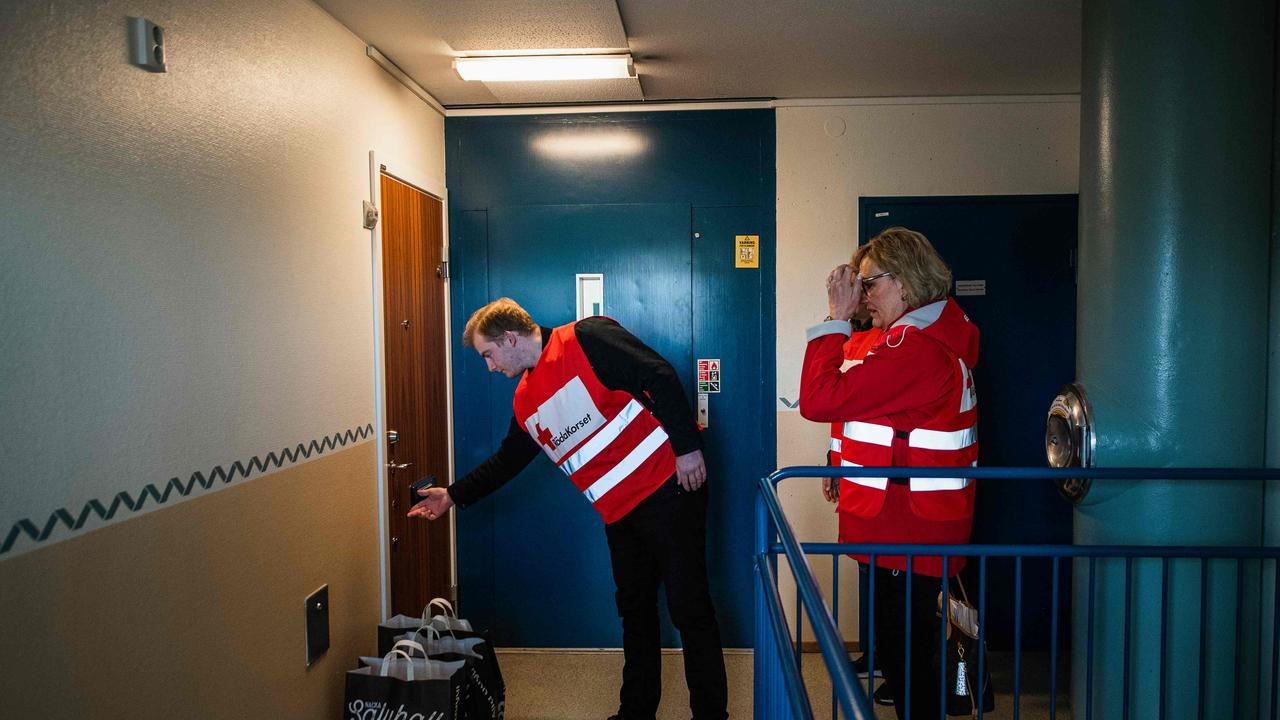 Swedish Red Cross volunteers deliver goods to elderly residents in Nacka, near Stockholm, to protect them from exposure to the coronavirus. Picture: AFP