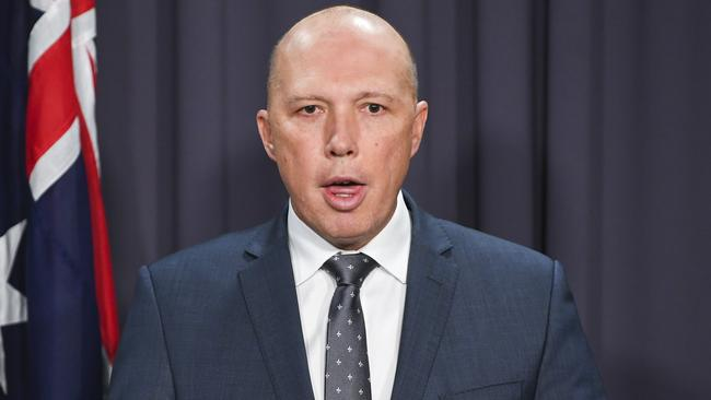 """Peter Dutton accused Bill Shorten of offering a """"backdoor"""" entry to Australia. Picture: AAP Image/Lukas Coch"""