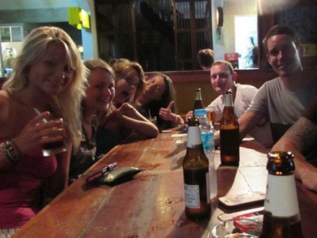 Last drinks ... Hannah (left) and David (second right) with David's friend Chris Ware on the evening they were killed. Picture: Supplied
