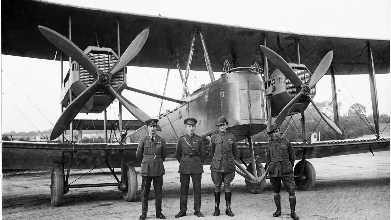 The Vickers Vimy crew, from left, Keith Smith, Ross Smith, James Bennett and Walter Shiers, with their plane at the start, in England, in 1919, for the race from England to Australia. Picture: State Library of SA