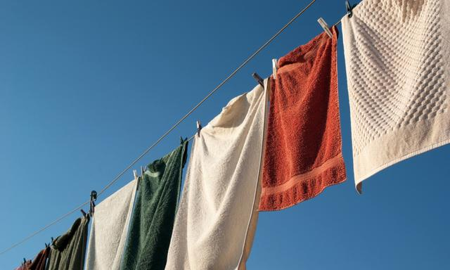 Towels on a clothes line against a bright blue sky.Similar Images: