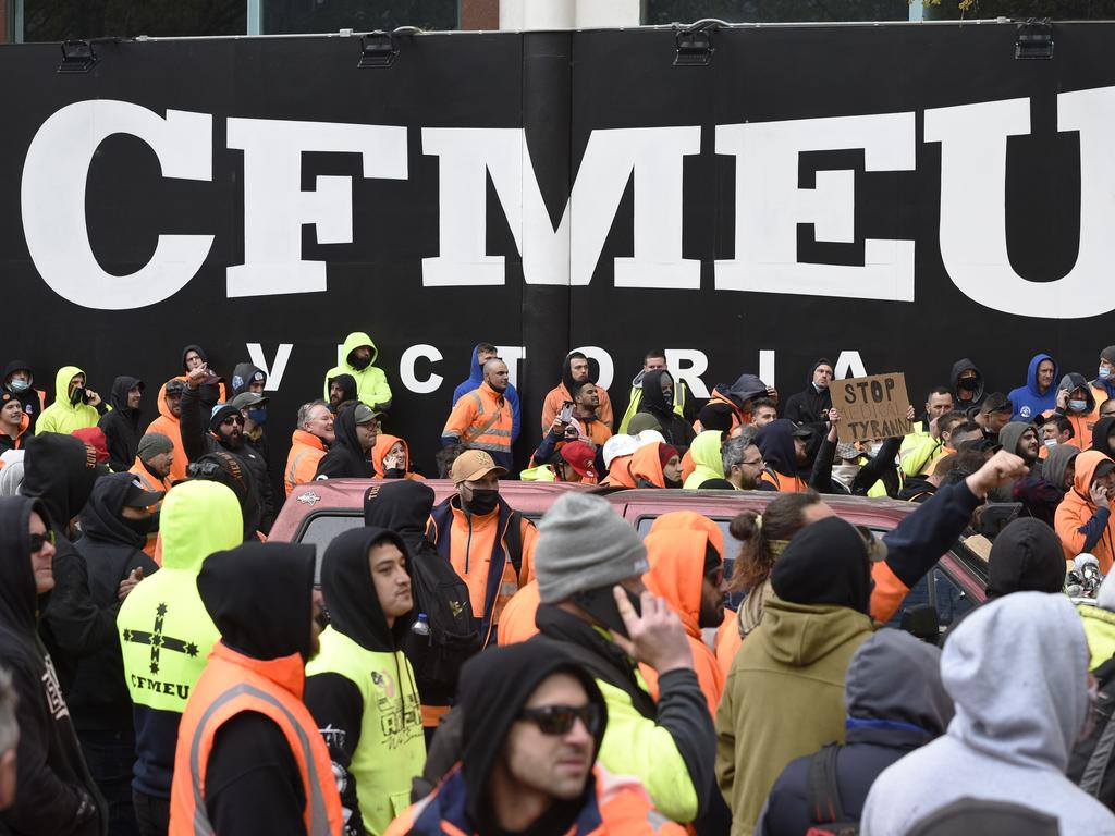 Construction workers gather outside the CFMEU offices in Melbourne. Picture: Andrew Henshaw