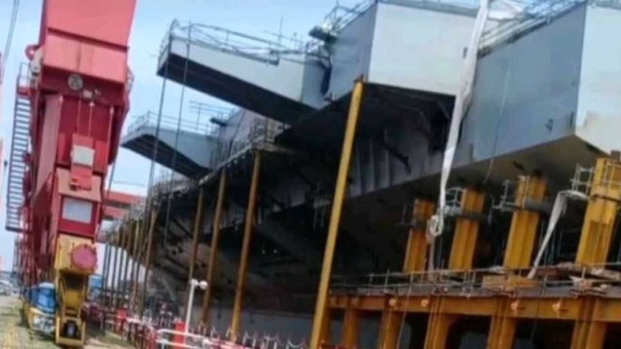 This photo, removed shortly after it was uploaded to TikTok, reveals the stern-port (back left) quarter of the Type 003 currently under construction in China. Visible is the large overhang of the angled flight-deck and sponsons (extensions) that will likely carry landing aids and defensive equipment. Picture: TikTok