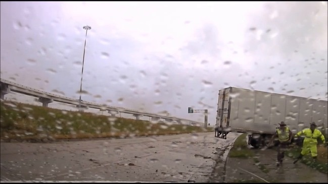 'Close Call': Texas Police Run for Their Lives as Second Semi Careers off Interstate