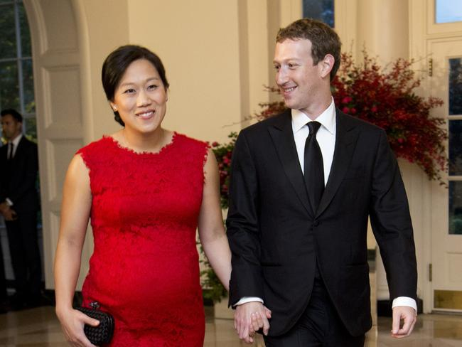 Priscilla Chan and Mark Zuckberg  arrive for a State Dinner in honour of Chinese President Xi Jinping at the White House in 2015.