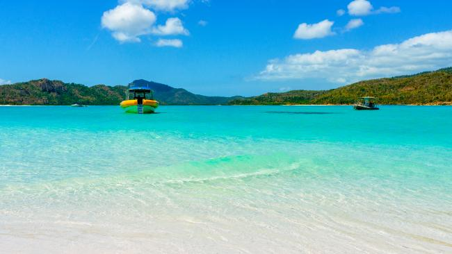 Be prepared to spend some money, like booking a snorkelling tour to Whitehaven Beach. Picture: Getty Images
