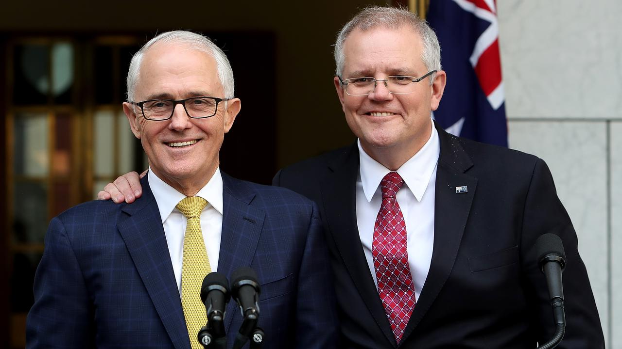 Scott Morrison's beaming face, proudly supporting former PM Malcolm Turnbull before he was ousted, has been at the forefront of Labor campaigns. Picture: Kym Smith