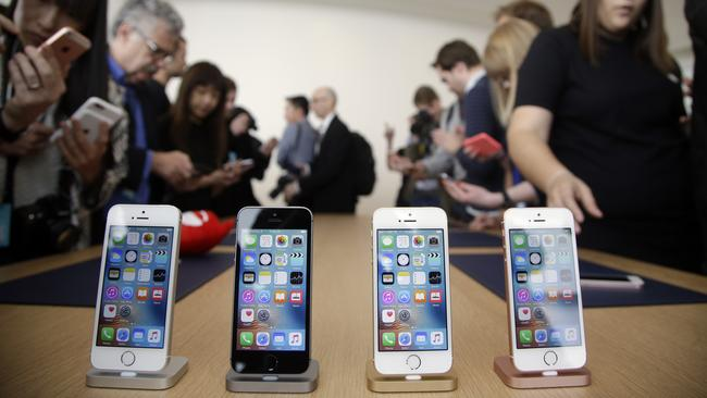 The different coloured models of the new iPhone SE in all their glory. Picture: AP/Marcio Jose Sanchez