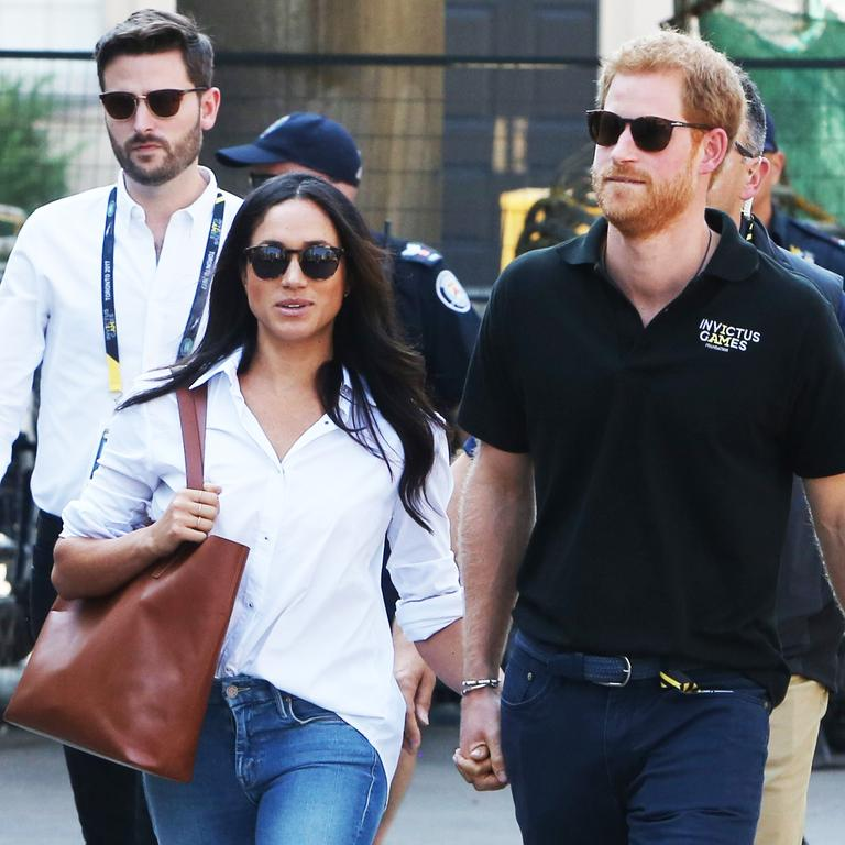 Jason Knauf (left) is pictured with Harry and Meghan. Picture: Splash News/Media Mode