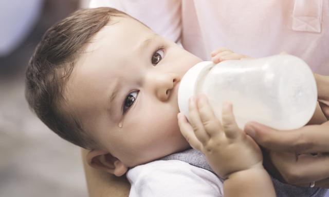 Dad Feeding his Baby Boy with Milk Bottle