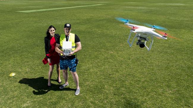 Drone pilot Chris Garnaut, shows Vetti Kakulas the ropes to flying a drone. Picture: News Corp Australia
