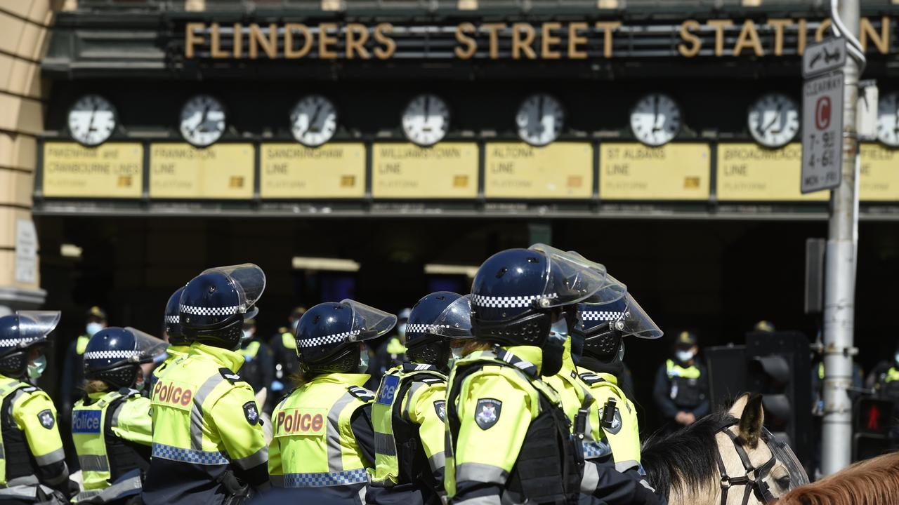 Police outside Flinders Street Station in Melbourne. Picture: NCA NewsWire / Andrew Henshaw