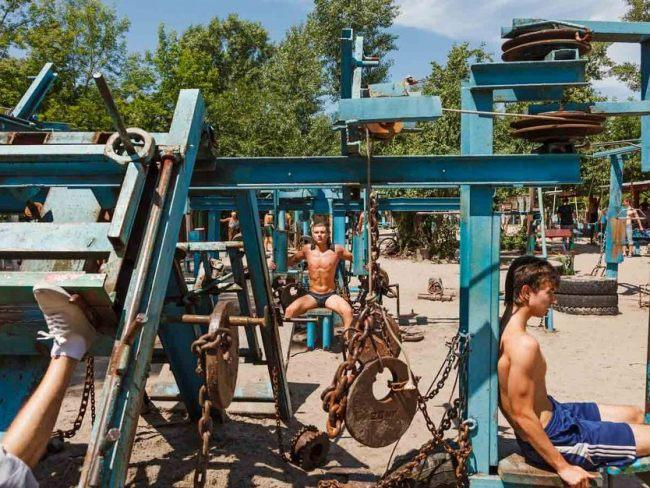 KACHALKA MUSCLE BEACH, KYIV, UKRAINEIf the Mad Max film's had a gym scene, you better bet it would be like this. Set up on the banks of the Dnieper River, chunks of Soviet machinery have been repurposed for a new purpose - building those guns. If you visit, jump in the river for a cool off afterwards. Picture: Imgur