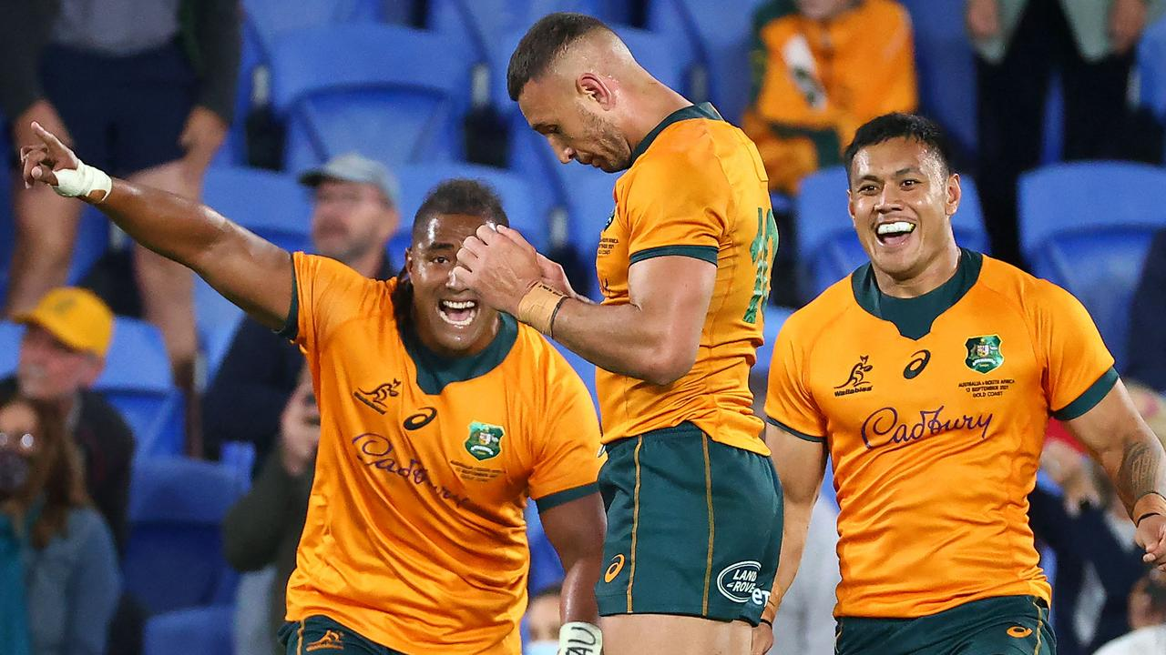 Australian players celebrate Cooper after his winning penalty kick. Picture: Patrick Hamilton / AFP