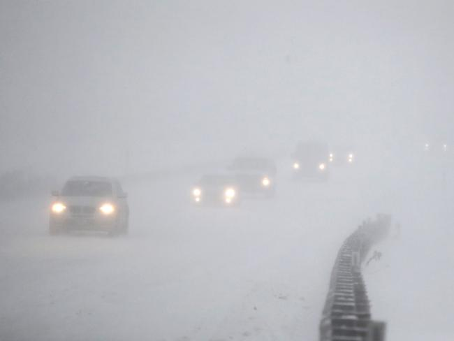 Vehicles commute to New York from New Jersey. Authorities advised people to stay off the road. Picture: AP/Julio Cortez