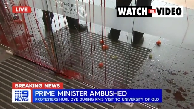 PM ambushed by protesters in Brisbane (9 News)