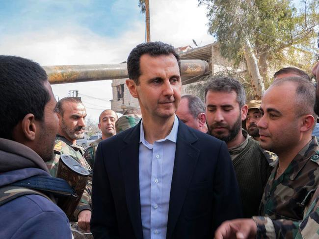 Syrian President Bashar al-Assad talks with government troops in Eastern Ghouta, in the leader's first trip to the former rebel enclave outside Damascus in years. Picture: AFP