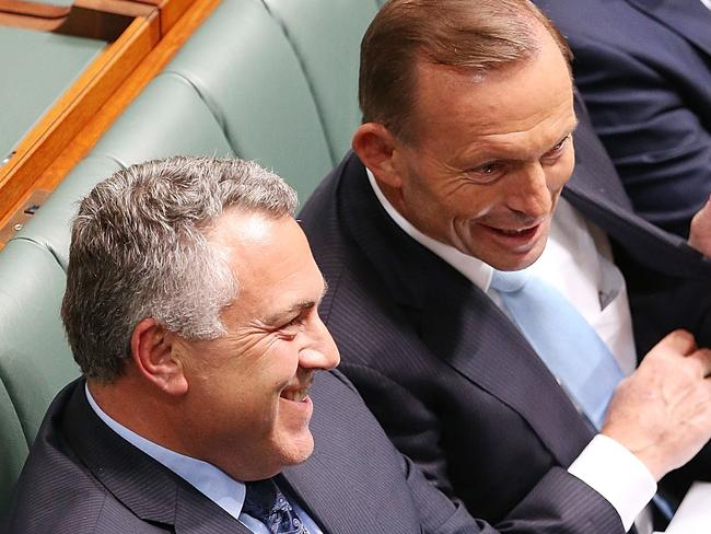 All smiles... Joe Hockey and Tony Abbott during Question Time yesterday. Picture: Stefan Postles/Getty Images