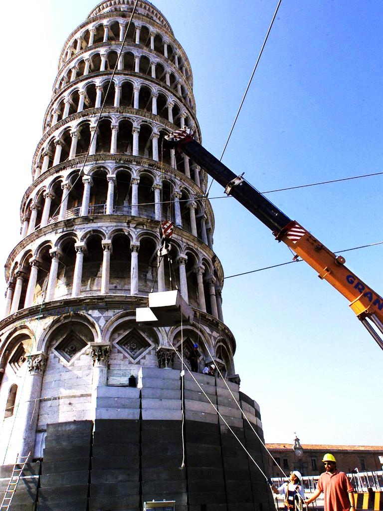 Workers removing blocks of lead from the base of leaning Tower of Pisa in 1999.