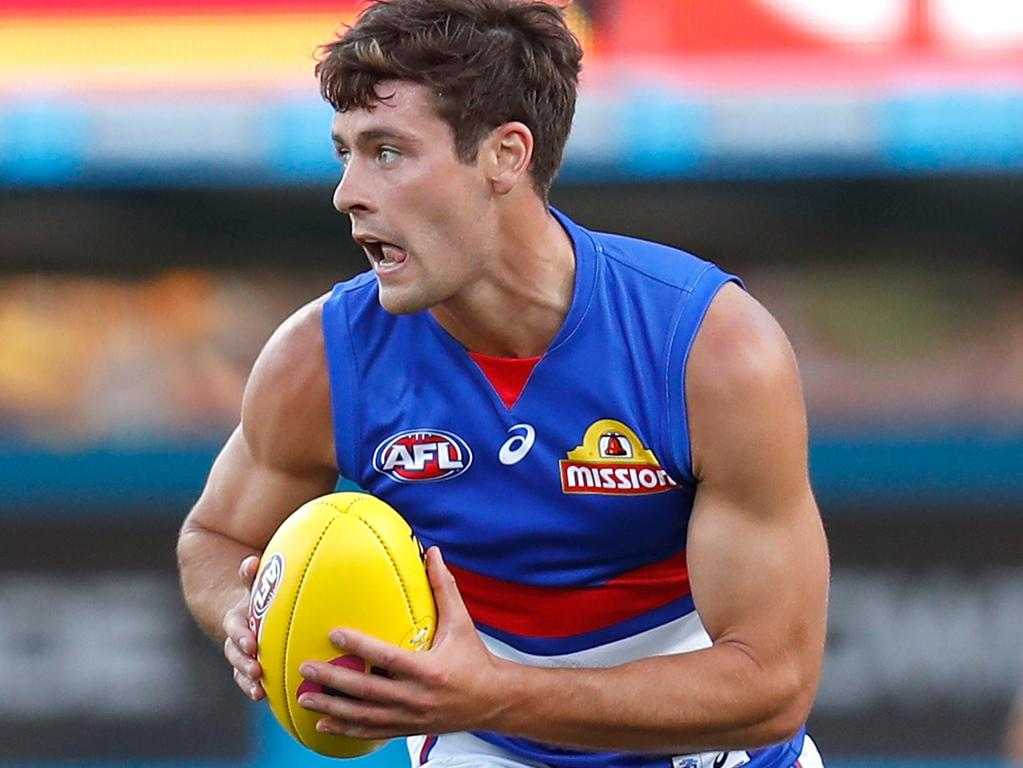BRISBANE, AUSTRALIA - OCTOBER 03: Josh Dunkley of the Bulldogs in action during the 2020 AFL Second Elimination Final match between the St Kilda Saints and the Western Bulldogs at The Gabba on October 03, 2020 in Brisbane, Australia. (Photo by Michael Willson/AFL Photos via Getty Images)