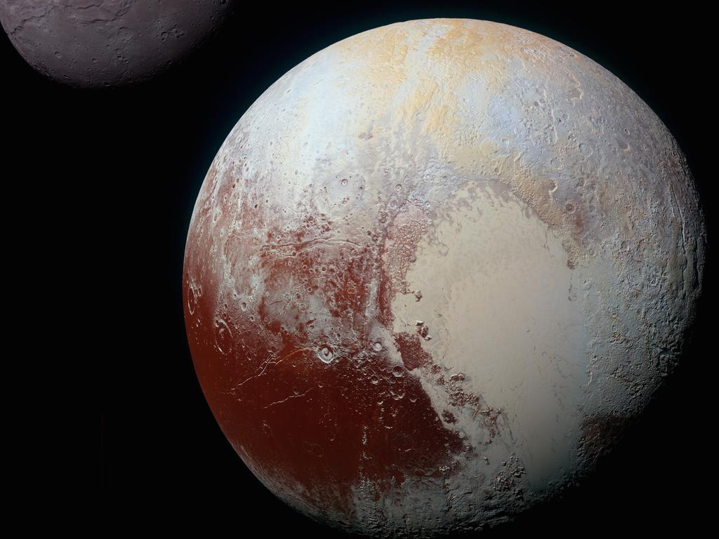 Composite of enhanced color images of Pluto (lower right) and Charon (upper left), was taken by NASA's New Horizons spacecraft as it passed through the Pluto system on July 14, 2015. Courtesy NASA, public domain