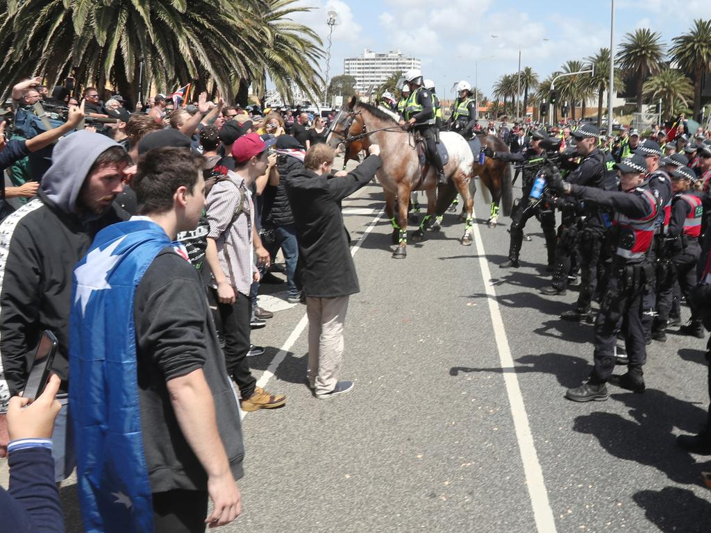 Police keep protesters apart on the St Kilda foreshore in Melbourne, January 5, 2019. Picture: David Crosling/AAP