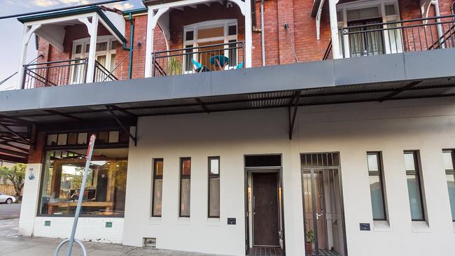 This Marrickville shopfront was converted to a home and sold for $1.087 million at auction.