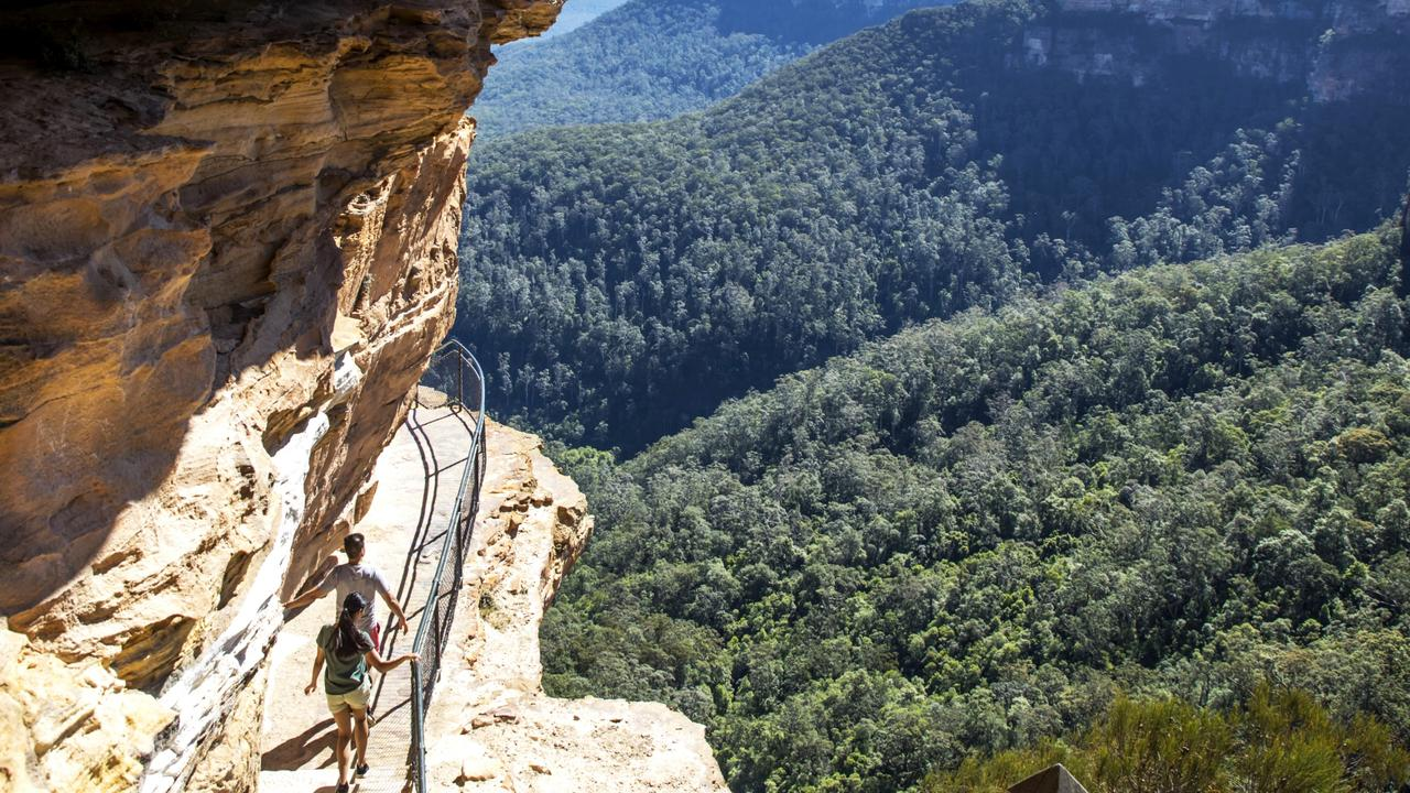 Couple enjoying a walk along the Wentworth Falls Track in the Blue Mountains National Park.