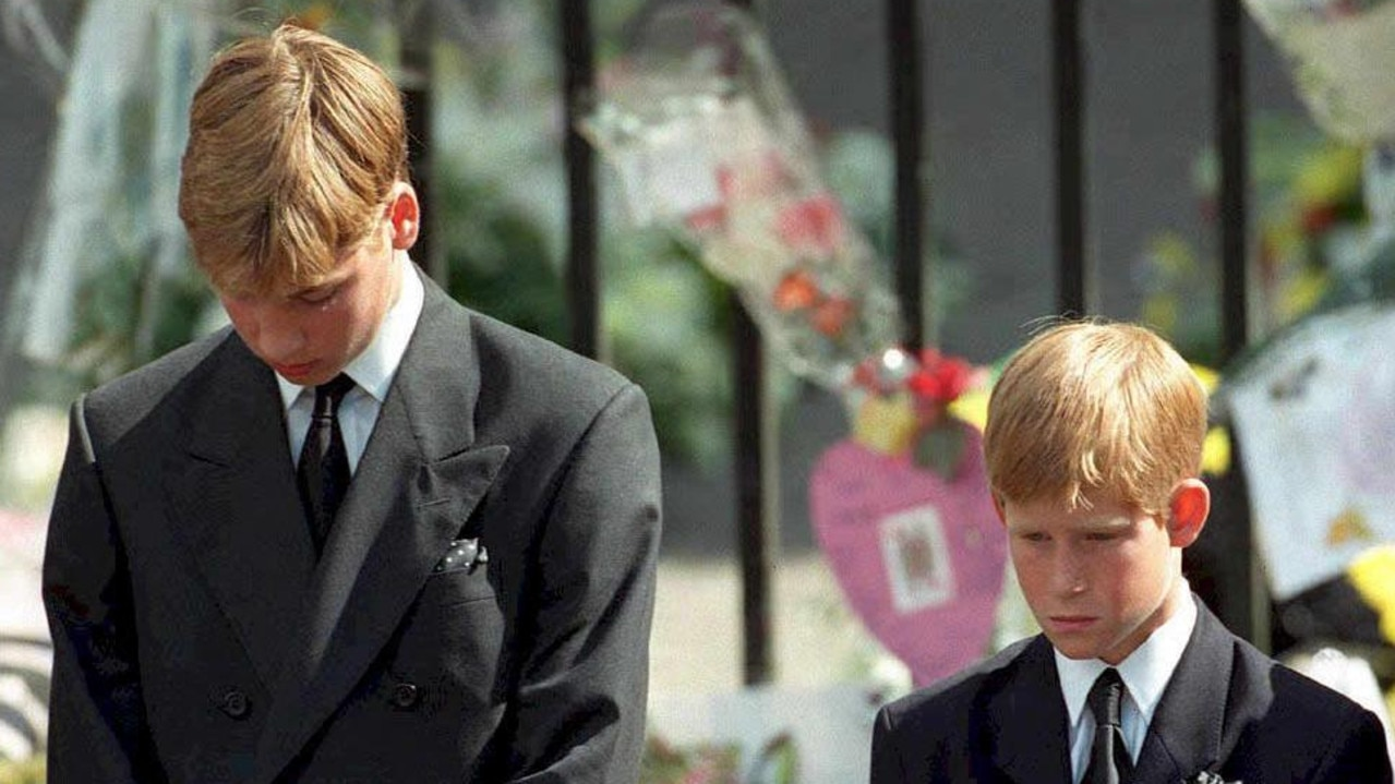 Britain's Prince William (L) and Britain's Prince Harry bow their heads as their mother's coffin is taken out of Westminster Abbey. Picture: ADAM BUTLER / POOL / AFP