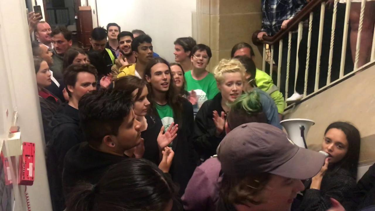 A video grab of protestors blocking the entrance to a talk by Bettina Arndt at Sydney University. Riot Squad police were called.