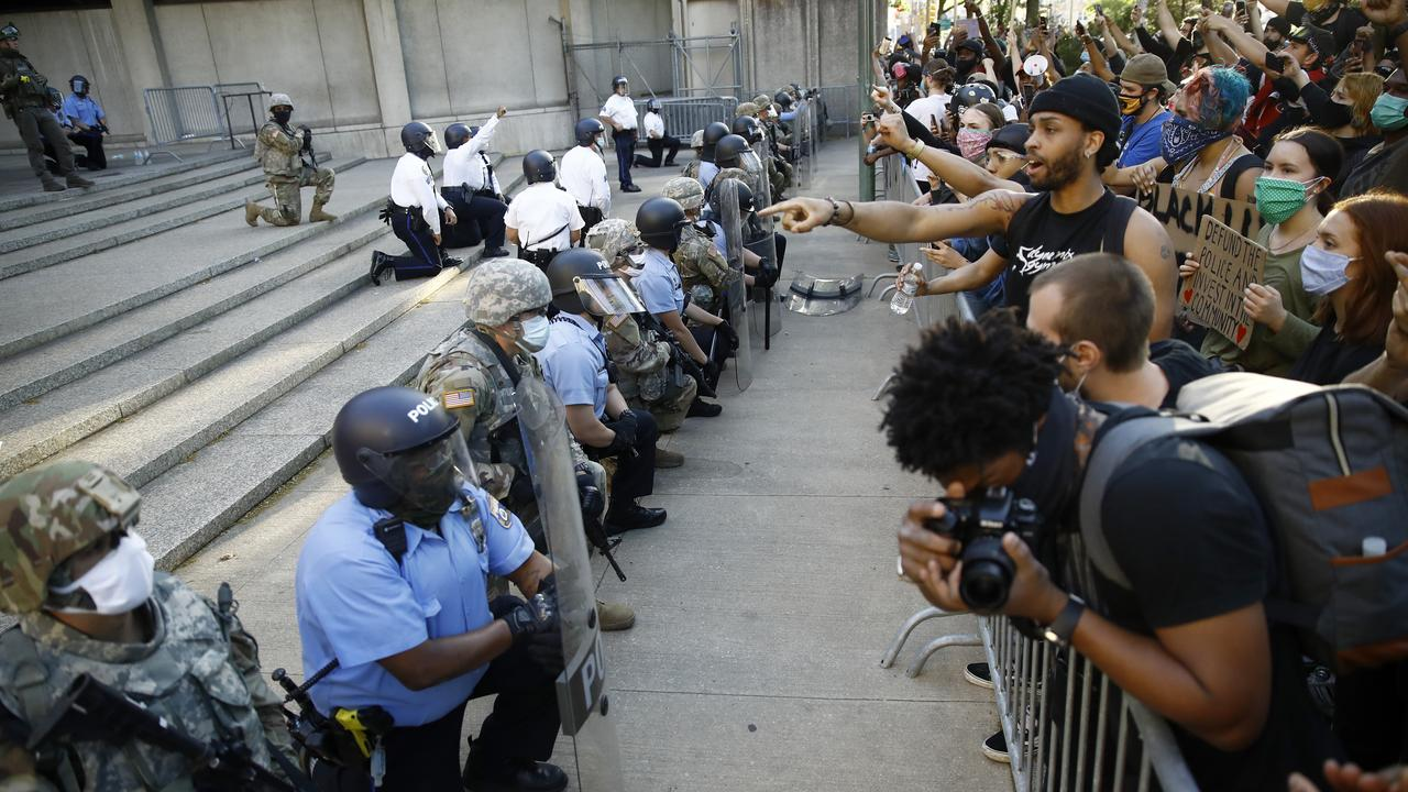 Philadelphia police and National Guard take a knee at the suggestion of Philadelphia Police Deputy Commissioner Melvin Singleton outside the police headquarters. Picture: Matt Slocum/AP