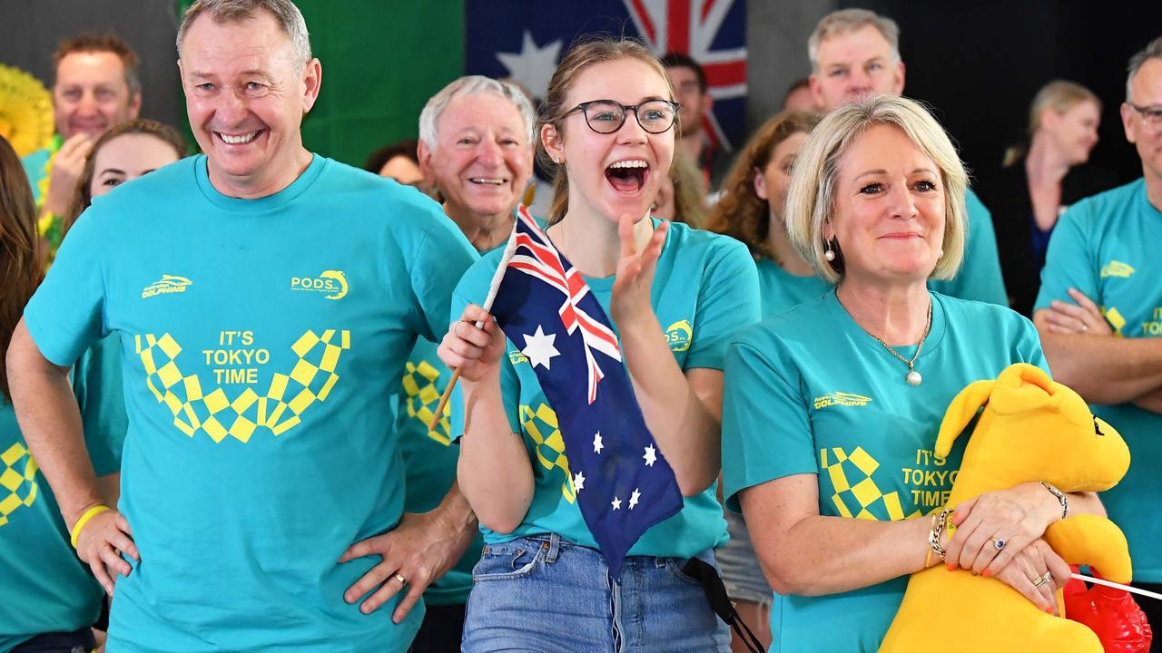 Ariarne Titmus' parents Steve and Robyn with daughter Mia watching her win the 400m freestyle on Monday. Picture Patrick Woods.