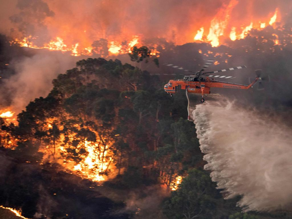 A helicopter fighting a bushfire near Bairnsdale in Victoria's East Gippsland region. Pic: AFP