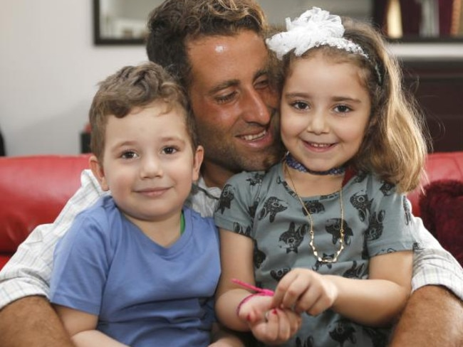 Noah (left) and Lahela with their father Ali Elamine in their family home in Beirut. Picture: Reuters/Mohamed Azakir