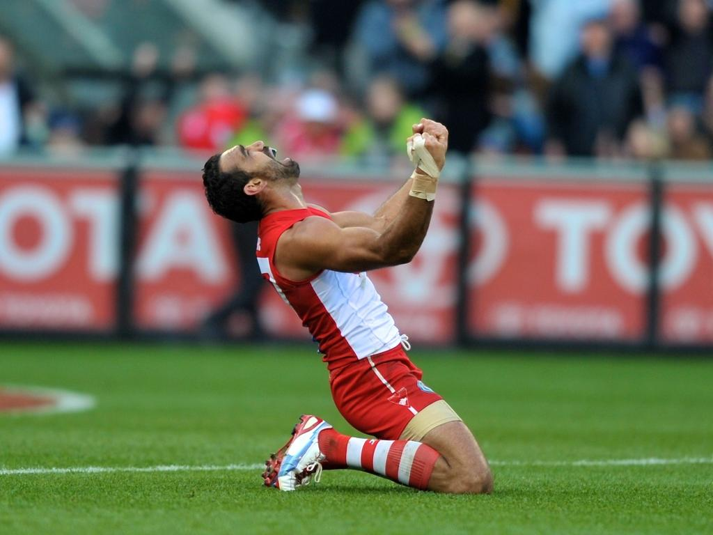 Adam Goodes celebrates after winning his second flag in the 2012 Grand Final. Picture: Wayne Taylor