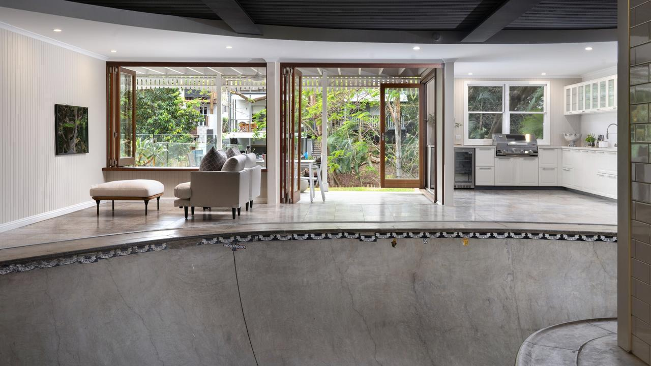 The huge concrete skate bowl inside one of the living areas of the home. Picture: Place Estate Agents.
