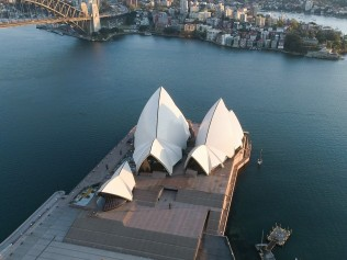 """Aerial photo taken on Sept. 9, 2021 shows Sydney Opera House in Sydney, Australia. Australian state of New South Wales NSW, the epicenter of the country's current outbreak, unveiled on Thursday a """"roadmap to freedom"""" out of the prolonged lockdown that has been imposed on much of the state as it has battled to contain an escalating outbreak of COVID-19. (Photo by Hu Jingchen/Xinhua via Getty Images)"""