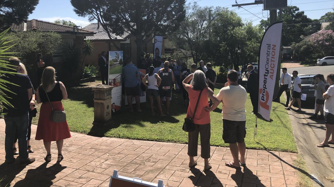 About 50 people gathered to watch the property go to auction.