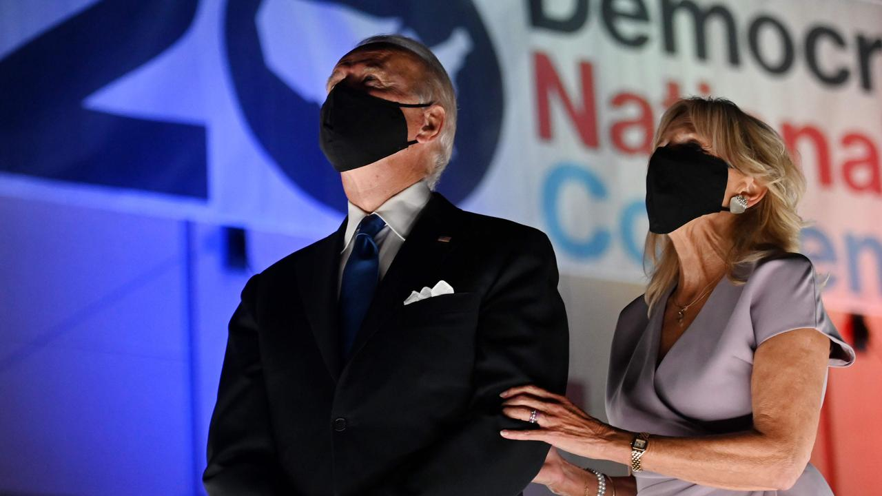 Joe and Jill Biden wear face masks at the conclusion of the Democratic National Convention, which was held virtually amid the pandemic. Picture: Olivier Douliery/AFP