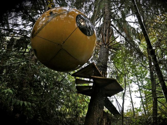 "FREE SPIRIT SPHERES, CANADA: The world's first spherical tree houses are suspended in rainforest on Vancouver Island, about 45 minutes from Nanaimo. Several metres from the ground, the treetop experience is described as ""like being in a nut shell that's decorated like a palace"". The concept is all about living harmoniously within nature, but when it comes to – ahem – answering the call of nature, you need to pop down to the composting toilet outhouse below. Rates for the spheres start from $C334 ($346). See  freespiritspheres.com Picture: Adam Clarke / Free Spirit Spheres"