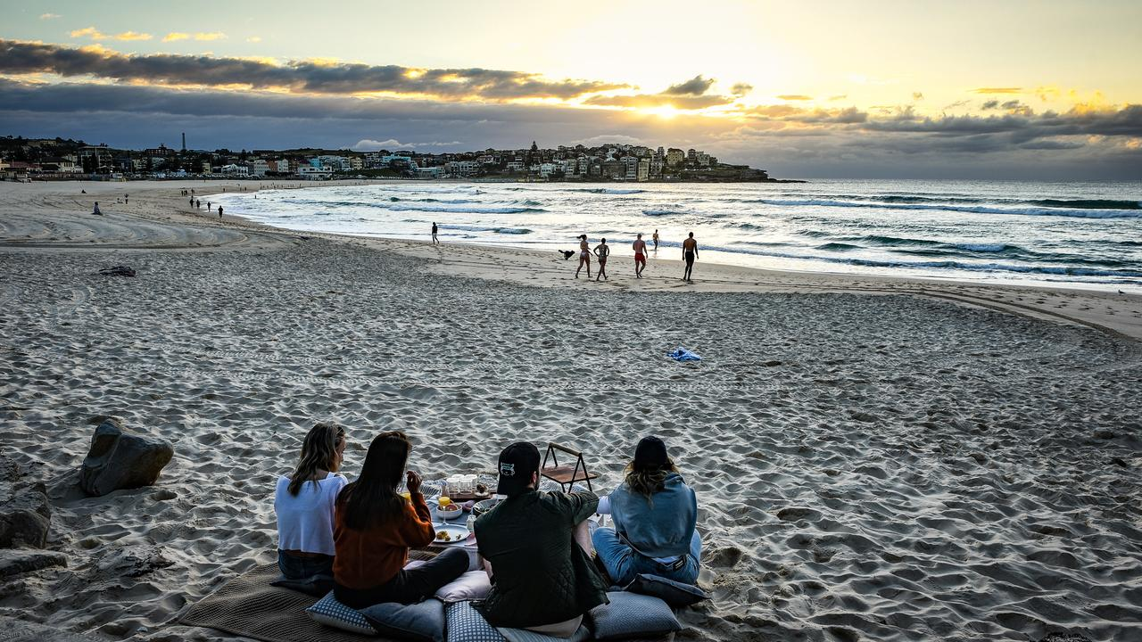 People having picnics on Monday as double vaccinated residents are allowed to gather in five or more outdoors at Bondi Beach in Sydney. It's a different story across the rest of the world though. Picture: NCA NewsWire / Flavio Brancaleone