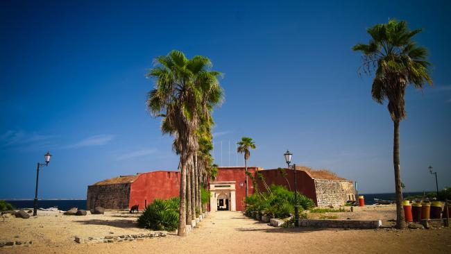 8/24Goree Island, Senegal A west coast hub, Goree Island near the capital of Dakar also imprisoned enslaved peoples before shipping them out as part of the international slave trade. It too has become a pilgrimage site for those wanting to connect with their African roots. The Maison des Esclaves is a poignant reminder of the transatlantic trade; it too has a Door of No Return.