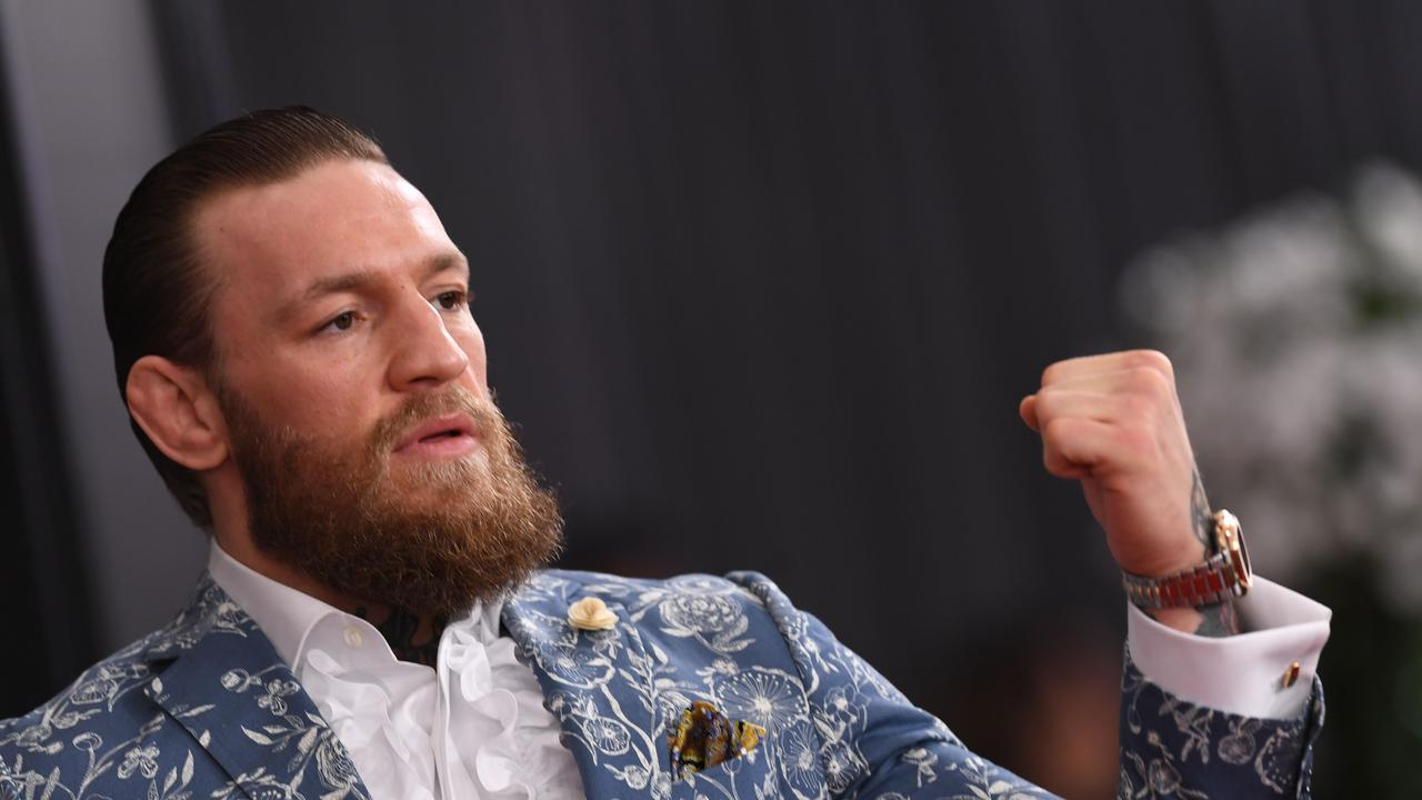 Dustin Poirier has claimed Conor McGregor has not made the donation yet. (Photo by VALERIE MACON / AFP)