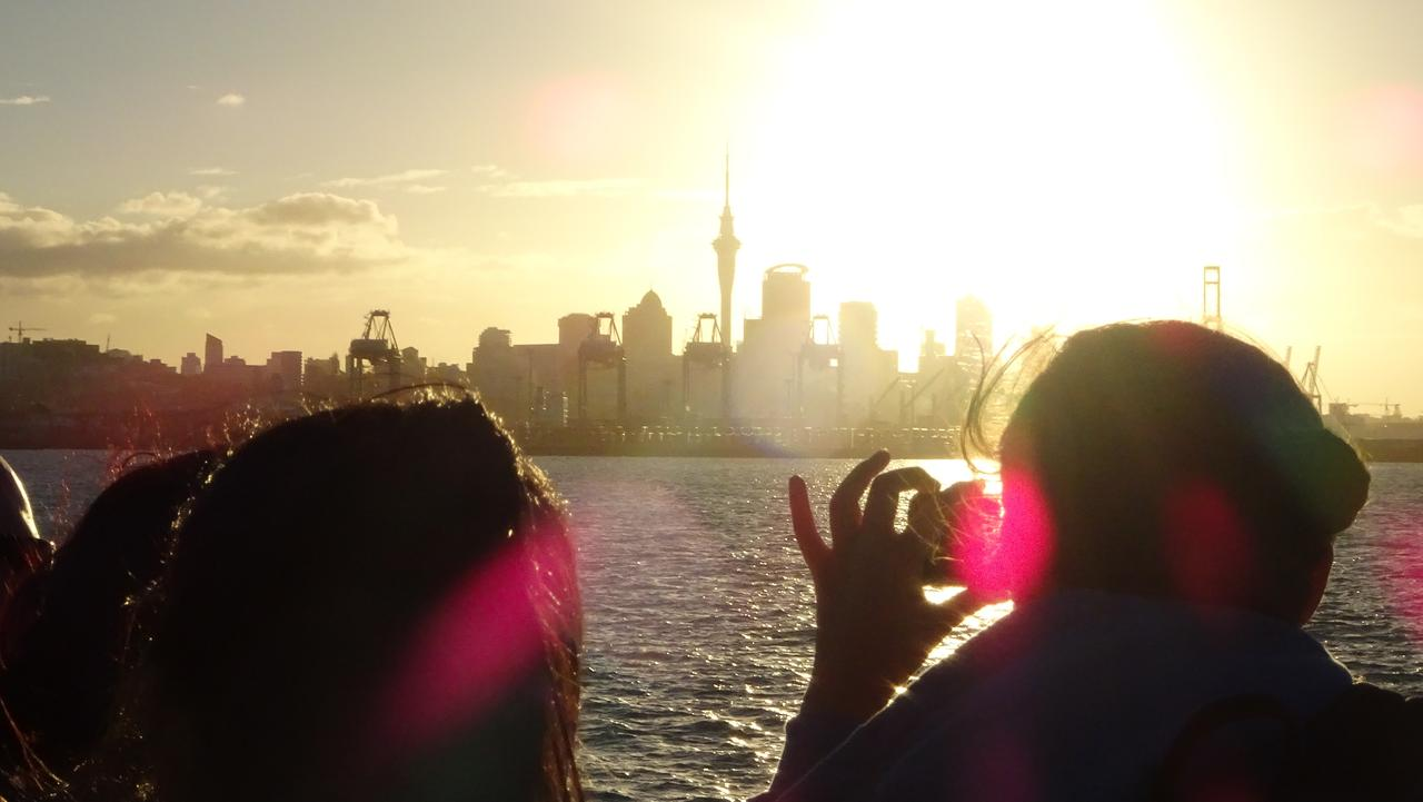 Shh! The sun sets over Auckland as the evening ferry returns from Waiheke Island. Picture: AAP