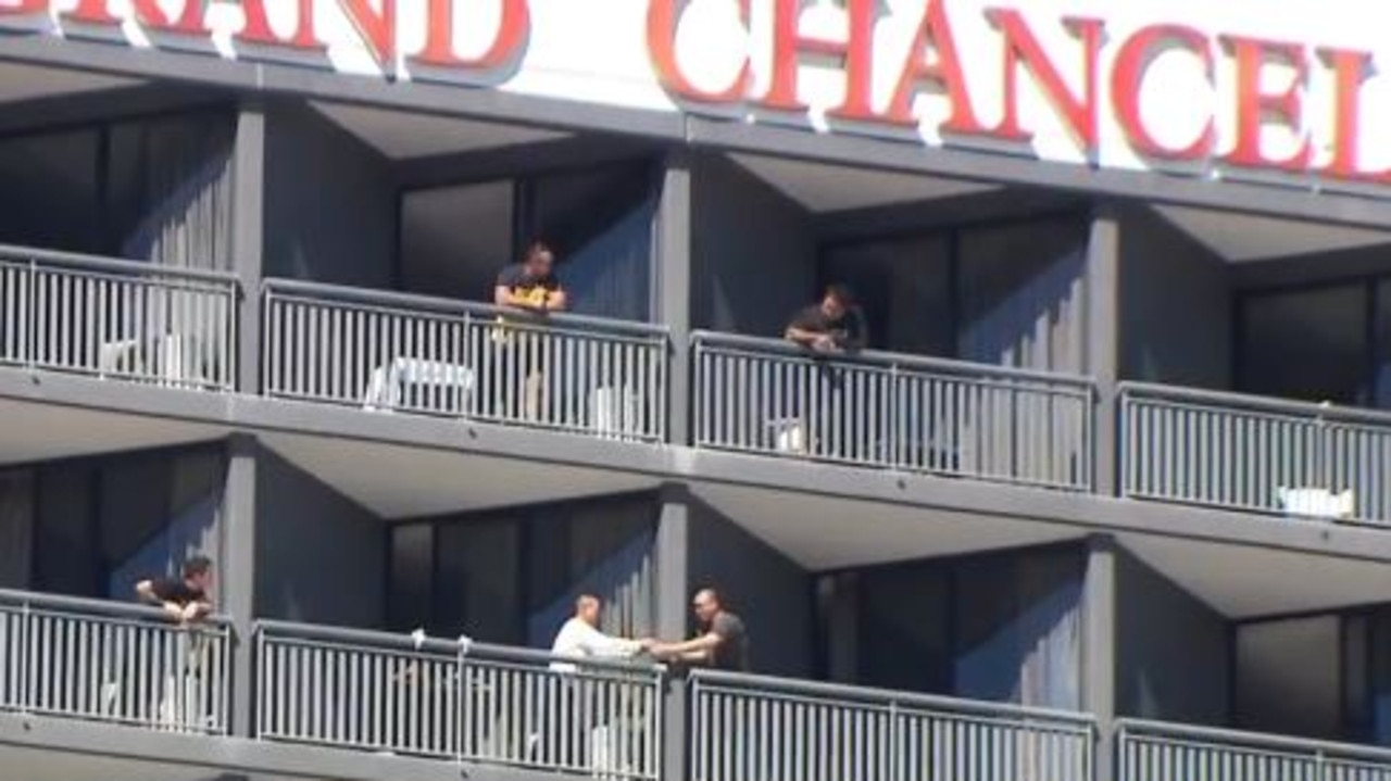 Quarantined visitors have been filmed passing items to one another over balconies at Brisbane's Hotel Grand Chancellor. Picture: Sunrise