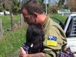 David Ayles embraces pregnant woman who has been alone and isolated from civilisation for days after Cyclone Debbie hit.
