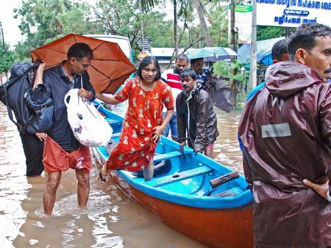 Indian volunteers evacuate local residents in a boat at Kozhikode, in the Indian state of Kerala. Picture: AFP